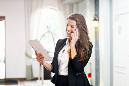 Picture of young businesswoman working in lobby Stock Photo