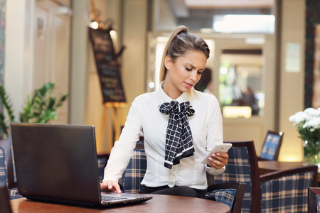 business woman working: Picture of young businesswoman working cafe