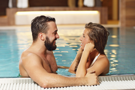 couple relaxing: Picture of happy couple relaxing in pool spa