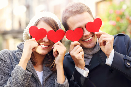 covering eyes: Picture of happy couple covering eyes with hearts
