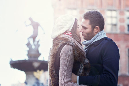 winter couple: Picture showing young couple kissing in Gdansk