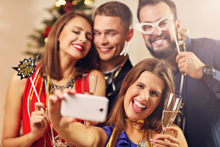 christmas cracker: Picture showing group of friends celebrating New Year