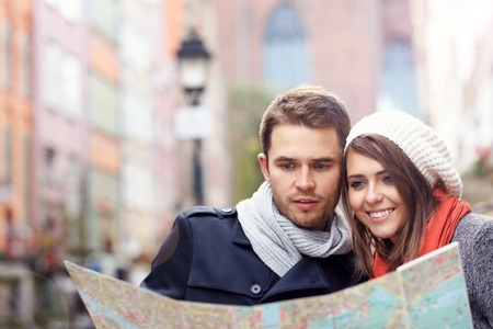 Picture showing young couple sightseeing with map