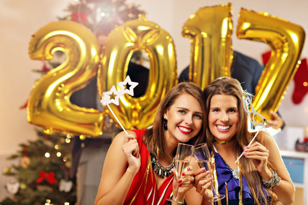 people laughing: Picture showing group of friends celebrating New Year