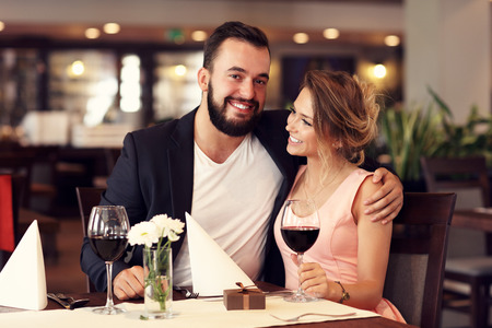rich people: Picture of romantic couple dating in restaurant