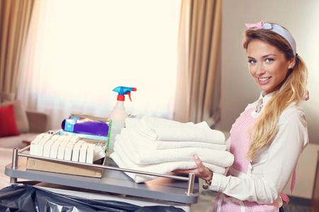 towel: Picture of maid with fresh towels in hotel room