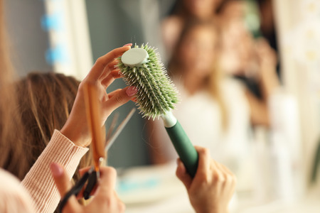 Picture showing hairdresser holding hair brush Stock Photo
