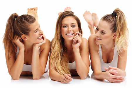 Group of happy friends in underwear over white background Stock Photo