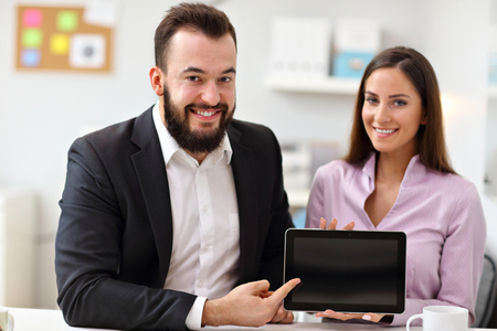 man at work: Businesspeople using their tablet Stock Photo