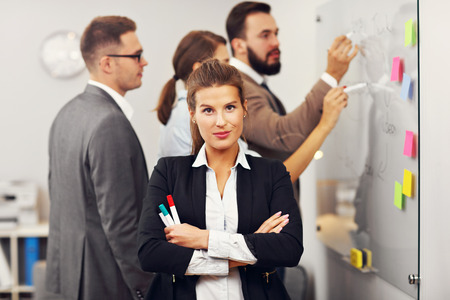 teamwork business: Picture showing confident businesswoman and her team