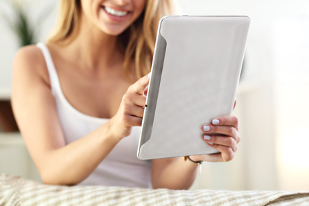 Picture showing happy woman with tablet on sofa Stock Photo