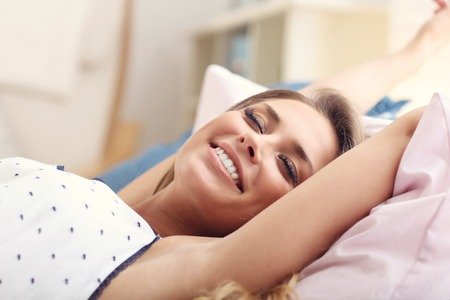 Picture of happy woman stretching in the morning