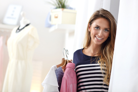 clothing shop: Happy woman shopping for clothes