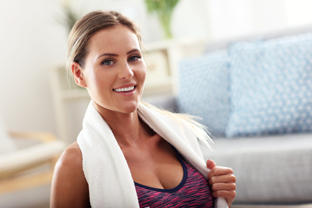 body shape: Fit girl working out at home in the living room