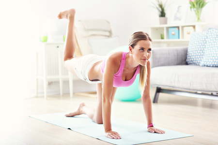 Sporty woman working on buttocks at home