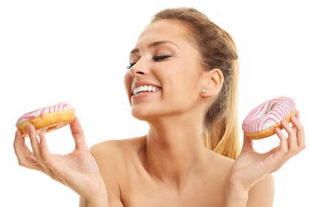 decission: Adult woman posing with donuts over white background Stock Photo