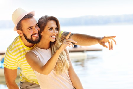 Happy couple having fun outdoors in summer