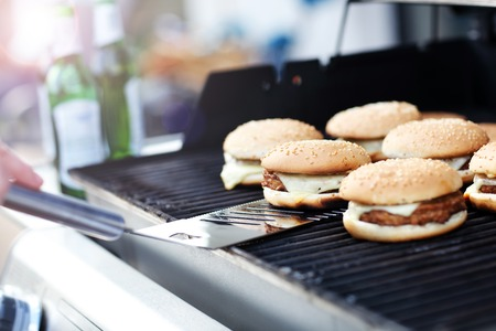 Cheeseburgers on the grill Stock Photo