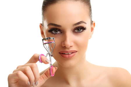 Picture showing woman using eyelash curler over white Stock Photo