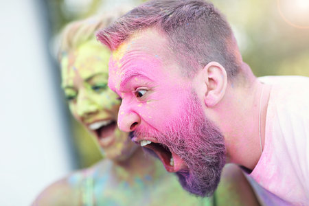 Group of friends having fun at color festival Stock Photo