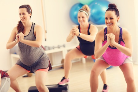 Group of pregnant women during fitness class Stock Photo