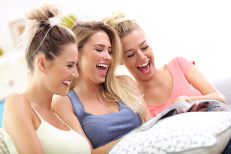 Three beautiful young women chilling at home Stock Photo