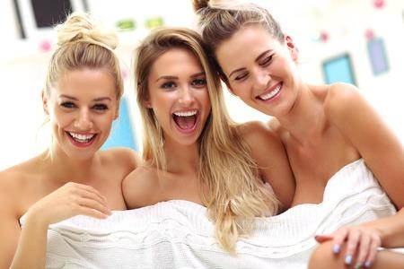 Three beautiful young women in home spa