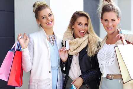 winter fashion: Happy group of friends shopping in autumn season