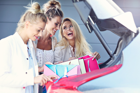 Happy group of friends shopping in autumn season