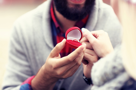Adult man giving engagement ring to beautiful woman Stock Photo - 88070591