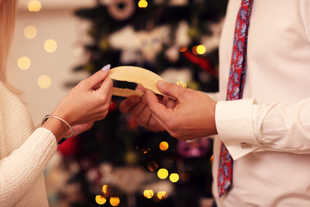 People sharing Christmas wafer in Poland