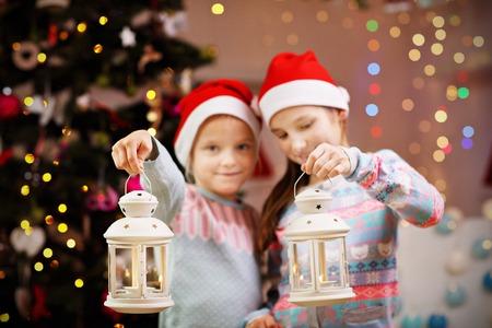 Happy children posing with Christmas lanterns Stock Photo
