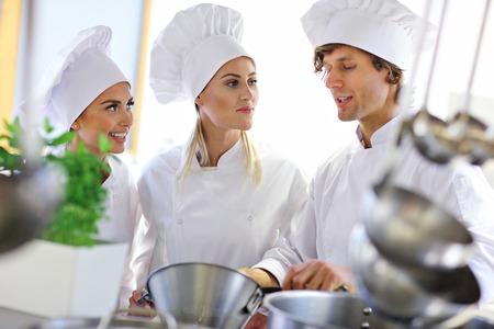 Busy chefs at work in the restaurant kitchen