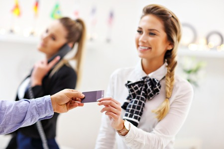 Hotel receptionist giving key card