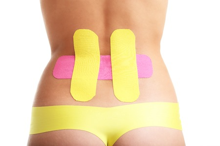 Picture showing special physio tape put on injured back over white background Stock Photo