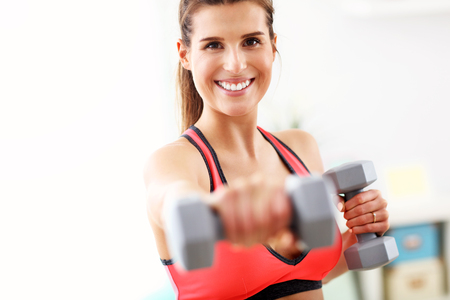 Woman doing fitness exercises at home Banco de Imagens