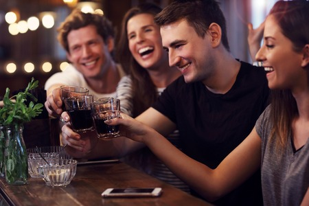 Group of friends watching soccer game in pub Stockfoto - 106977783