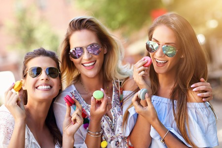 Happy girl friends hanging out in the city in summer Stock Photo