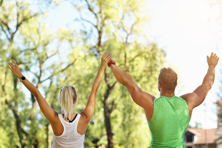 Young couple working out in park