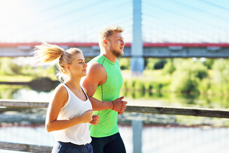 Young couple jogging in park 스톡 콘텐츠