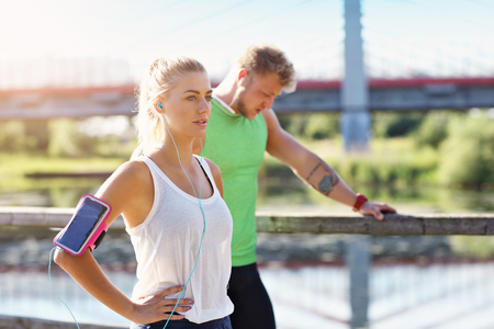Young couple jogging in park Stock Photo