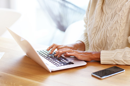 Picture of adult woman wearing warm sweater and working at home Stock fotó - 106917638