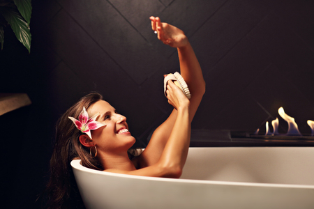 Adult attractive woman relaxing in bath tube Stock Photo
