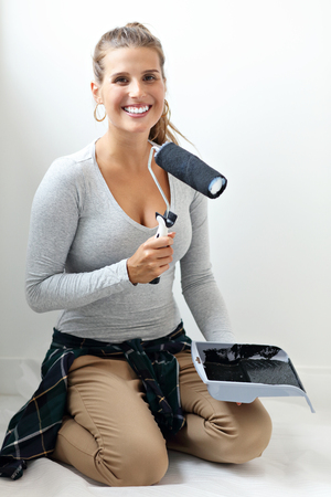 Mature woman doing home improvements 스톡 콘텐츠