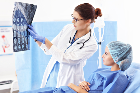 Female doctor taking care of patient in hospital