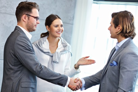 Group of business people introducing one another Stock Photo