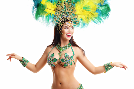 Brazilian woman posing in samba costume over white background