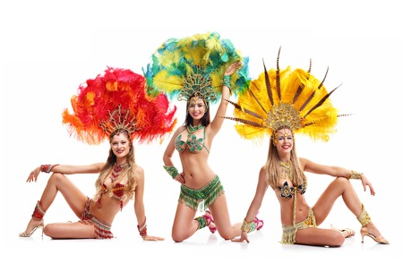 Brazilian women dancing samba over white background