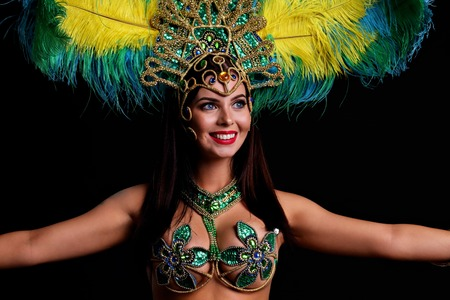 Brazilian woman posing in samba costume over black background