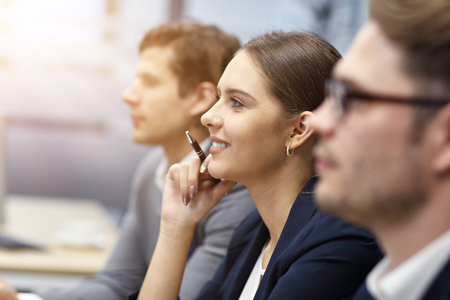 Group of business people attending a conference